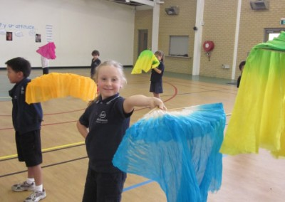 Year Ones learning traditional Chinese fan dancing.